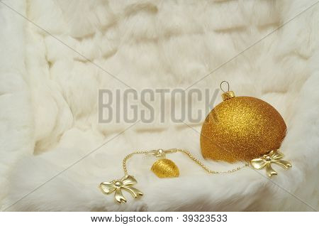 Christmas Decorations - Gold Ball And Bows On White Furs
