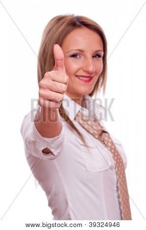 Young girl, with white shirt and casual necktie, showing thumbs-up, isolated on white - focus on the thumb
