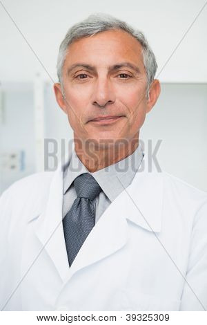 Smiling doctor wearing labcoat in hospital