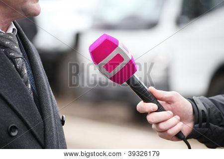 reporter interviews somebody