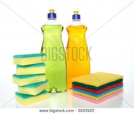 Bottles Of Dishwashing Liquid And Sponges