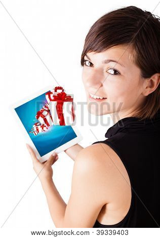 Young business woman looking at modern tablet with present boxes