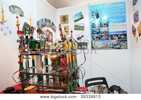 SUBANG JAYA - NOVEMBER 10: A complex programmed robot made by students from China prepares tea and serve them in tea-cups at the World Robot Olympaid on November 10, 2012 in Subang Jaya, Malaysia.