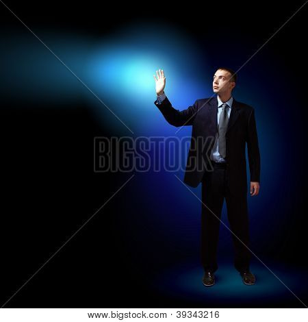 Businessman with light shining