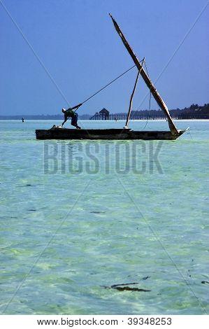 Beach And Man In Tanzania Zanzibar