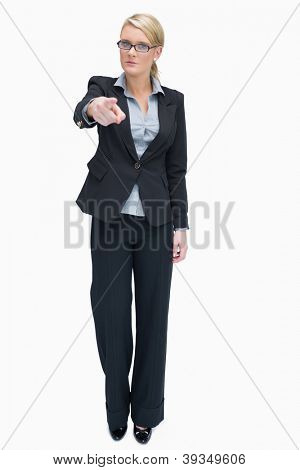 Angry businesswoman standing and pointing