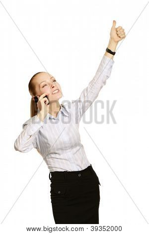A young successful businesswoman talking on the phone and showing ok, isolated on white background
