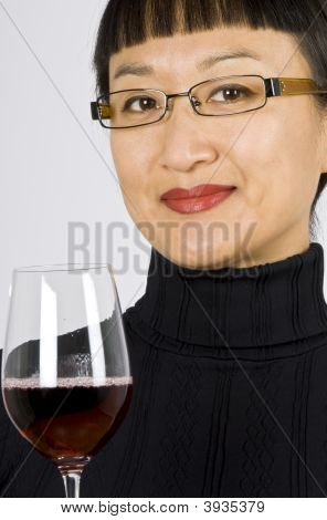 Asian Woman Wine Taster