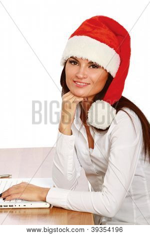 christmas woman working on a laptop - isolated on a white background