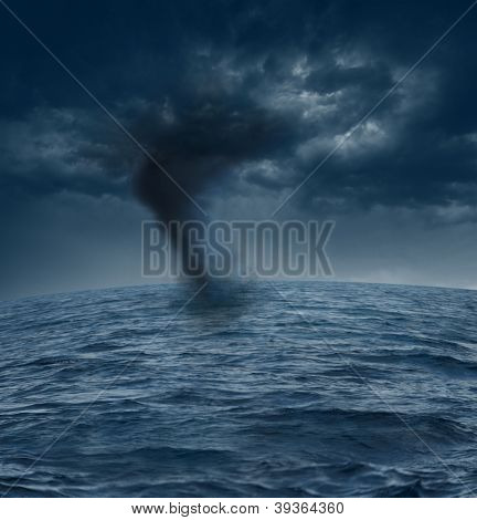 stormy clouds and tornado over the ocean
