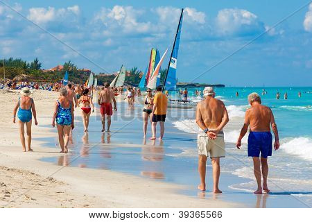 VARADERO,CUBA-NOVEMBER 4:Tourists enjoying the beach November 4,2012 in Varadero.With 50 hotels and about 20 000 rooms,Varadero is the main destination for tourists visiting Cuba