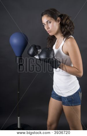 Young Beauty Woman Boxer Fighting With Punch Bag