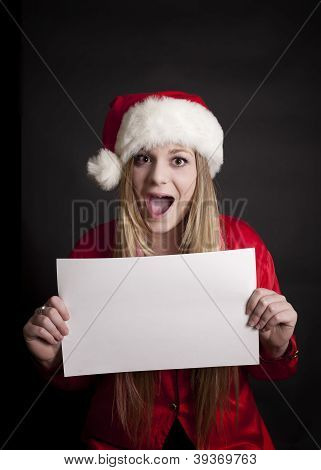 Girl with Santa Hat on and Blank Sign
