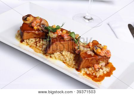 veal with durum on a white dish