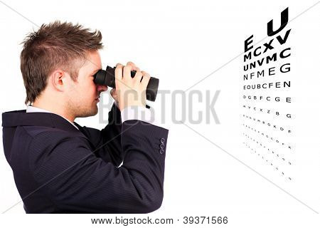 Man in suit doing an eye test with binoculars