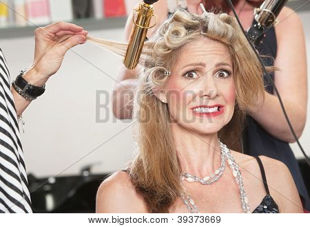 Anxious Woman With Hair Stylists