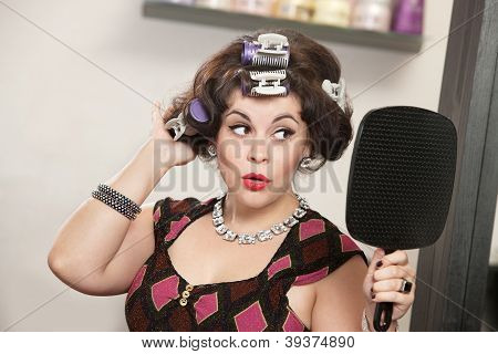Happy Woman Looking In Mirror