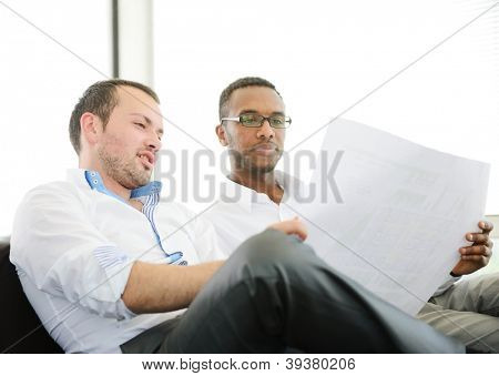 Two business men at work discussing a project