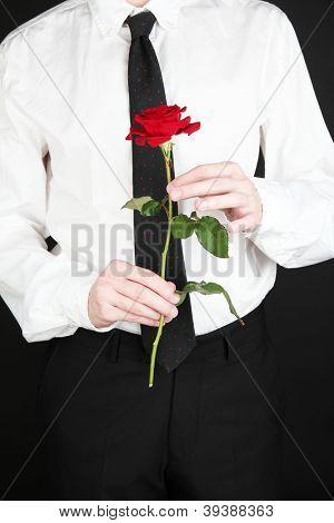 man holding rose close-up