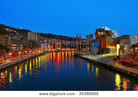 BILBAO, SPAIN - NOVEMBER 14: Estuary and Guggenheim Museum at night on November 14, 2012 in Bilbao, Spain. The picturesque museum was designed by Frank Ghery