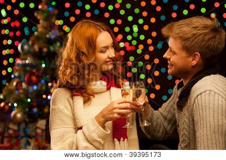 young happy smiling casual couple with wineglasses