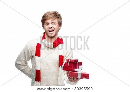 young winking man holding christmas gifts