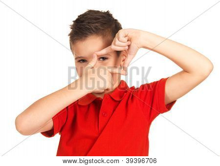 Boy Looking Through Frame Shape Made By Hands