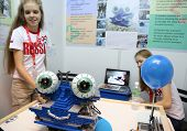 SUBANG JAYA - NOVEMBER 10: Unidentified Russian students shows a robot to people to exercise their e