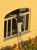 pic of window washing  - an early morning window washer - JPG