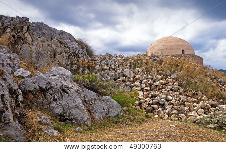 Inner Space Of Fortezza Castle With The Dome Of Old Ottoman Mosque On Background. Greece, Crete, Ret