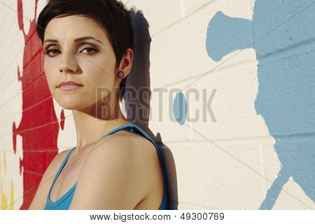 Closeup portrait of a fashionable impish young woman