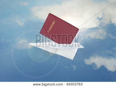 Blue paper airplane flight and passport