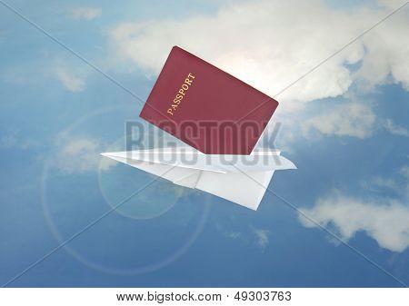 Blue paper airplane flight and passport