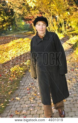 Senior Woman In Fall Park
