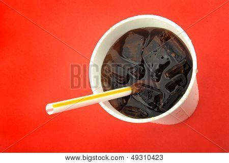 Close-up cup of Coca-Cola and ice