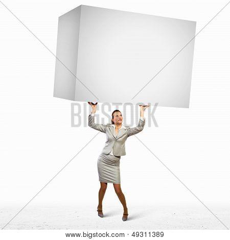 Businesswoman holding heavy cube