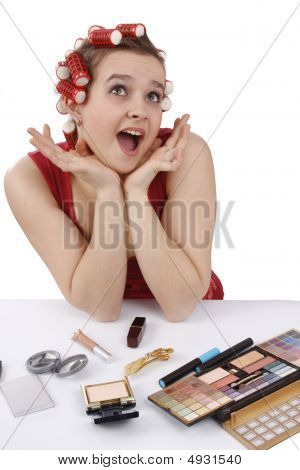 Woman With Curlers In Her Hair Looking Surprised.