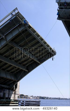 A drawbridge in the upright position along the Intracoastal Waterway.