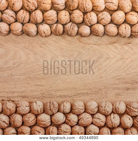 Unshelled Walnuts Lying On Desk