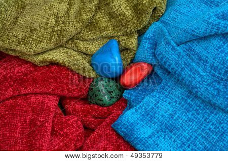 colourful stones between scarves