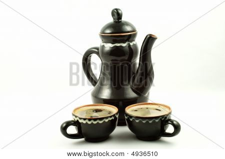 Clay Jug And Cups Filled With Pottery