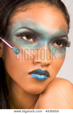 Mixed Race Woman Advertising Exotic Blue Make Up