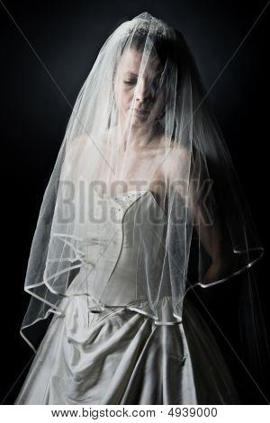 Shot Of An Unhappy Bride Against Dark Background