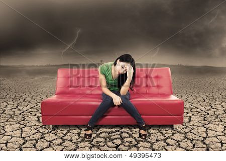 An Image Of Stress Female On Sofa And Dry Ground