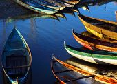 image of coracle  - in early moring this place concentrate many small craft of fisherman who live with fishery small bamboo craft with multicolor under golden light at sunrise make beautiful scene