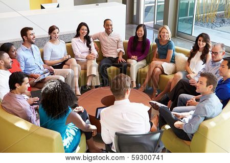 Multi-Cultural Office Staff Sitting Having Meeting Together poster