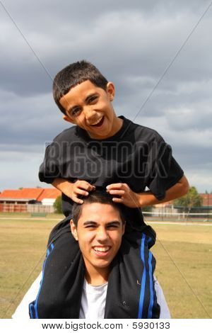 Teen and child playing