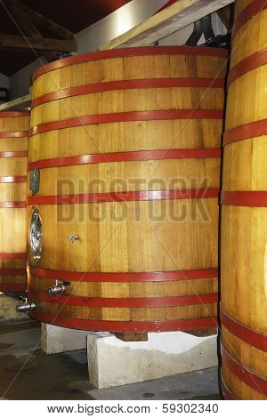 Wooden fermentation tanks at the vineyard