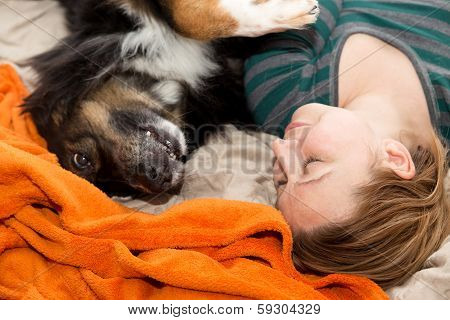 Woman Playing With Dog At The Ground