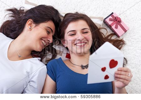 Happy Young Girls Reading Love Letter